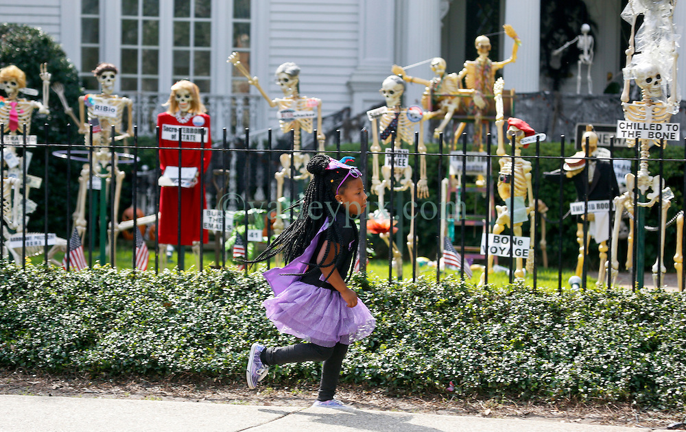 30 October 2015. New Orleans, Louisiana.<br /> The Skeleton Krewe mansion on St Charles Avenue at the corner of State Street draws a crowd of school children dressed in Halloween costumes with its satirically spooky Halloween decorations. <br /> Photo©; Charlie Varley/varleypix.com