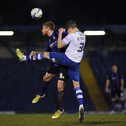 Bristol Rovers' Matt Harrold challenges Bury's Jim McNulty to the ball in the air - Photo mandatory by-line: Dougie Allward/JMP - Mobile: 07966 386802 01/04/2014 - SPORT - FOOTBALL - Bury - Gigg Lane - Bury v Bristol Rovers - Sky Bet League Two