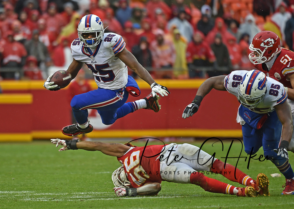Running back LeSean McCoy #25 of the Buffalo Bills leaps over the outstretched arm of Linebacker Derrick Johnson #56 of the Kansas City Chiefs at Arrowhead Stadium during the third quarter in Kansas City, Missouri.