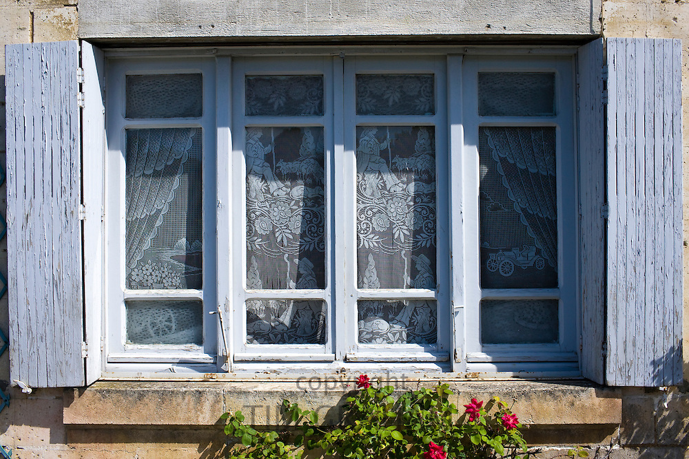 Typical French window with shutters in Bourdeilles near Brantome in Northern Dordogne, France