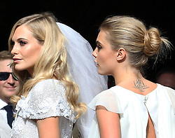 Poppy Delevingne arriving for her wedding with her sister Cara  at St.Paul's Church in Knightsbridge, London,  Friday, 16th May 2014. Picture by Stephen Lock / i-Images