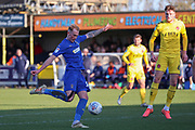 AFC Wimbledon midfielder Mitchell (Mitch) Pinnock (11) with a shot on goal during the EFL Sky Bet League 1 match between AFC Wimbledon and Fleetwood Town at the Cherry Red Records Stadium, Kingston, England on 8 February 2020.