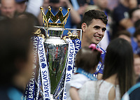 Football - 2014 / 2015 Premier League - Chelsea vs. Sunderland.   <br /> <br /> Chelsea's Oscar with the Premier League trophy at Stamford Bridge. <br /> <br /> COLORSPORT/DANIEL BEARHAM