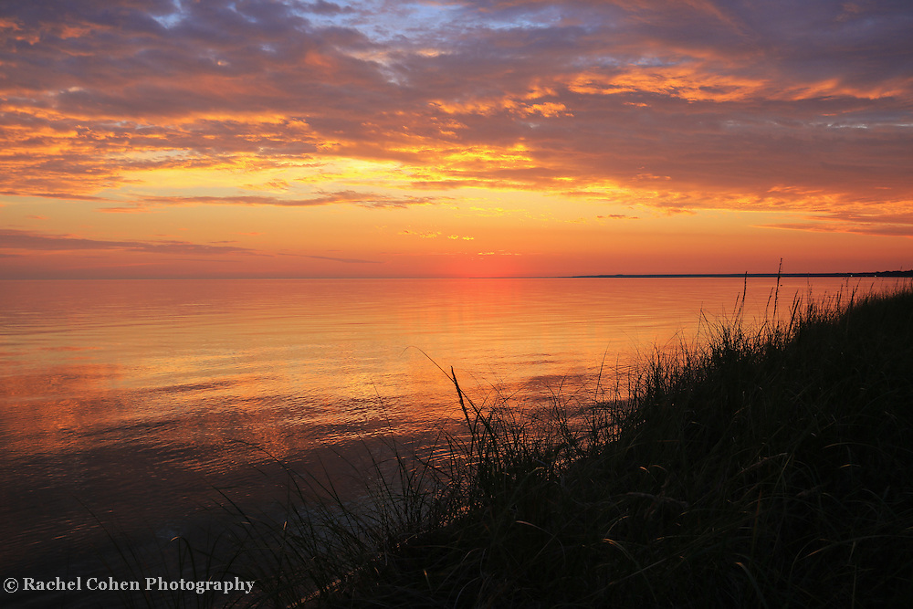 &quot;Dream On&quot;<br /> <br /> An amazing sunset on the shores of Lake Michigan near St. Ignace! Beautiful colors of gold, orange and purple adorn the sky and reflections on the glassy lake!