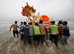 CHENNAI, Sept. 12, 2016 (Xinhua) -- Devotees push an idol of Hindu god Lord Ganesha into the sea in celebration of Ganesh Chaturthi festival in Chennai, Indian southeastern state of Tamil Nadu, Sept. 11, 2016. Ganesh Chaturthi is the Hindu festival celebrated in honor of the elephant-headed god Ganesha. (Xinhua/Stringer).****Authorized by ytfs* (Credit Image: © Stringer/Xinhua via ZUMA Wire)