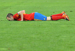 Andres Iniesta goes down during the 2010 FIFA World Cup South Africa Semi Final match between Germany and Spain at the Moses Mabhida  Stadium on July 7, 2010 in Durban, South Africa.
