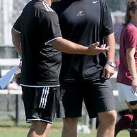 UNCW Head Coach Paul Cairney, left, talks to Elon Head Coach Chris Neal Sunday October 5, 2014. (Jason A. Frizzelle)