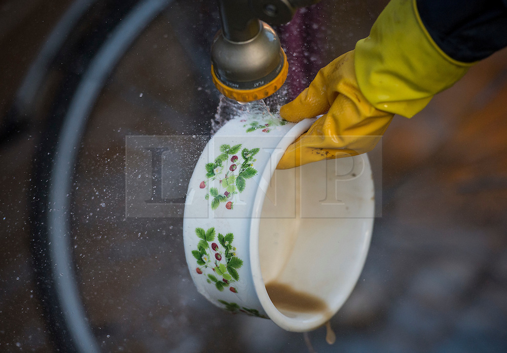 © Licensed to London News Pictures. 29/12/2015. York, UK. Mad from flood water being washed from personal belongings outside a property on Huntington Road in central York. Further rainfall is expected over coming days as Storm Frank approaches the east coast of the country. Photo credit: Ben Cawthra/LNP