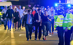 © Licensed to London News Pictures. 03/06/2017. London, UK. Members of the public flee near London Bridge following a terrorist attack involving a vehicle and pedestrians. A white transit van deliberately ran down people crossing the bridge and three men jumped out attacking people with knives. Photo credit: Ben Cawthra/LNP