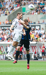 SWANSEA, WALES - Sunday, October 2, 2011: Swansea City's Angel Rangel in action against Stoke City's Robert Huth during the Premiership match at the Liberty Stadium. (Pic by David Rawcliffe/Propaganda)