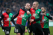 NIJMEGEN, NEC - Achilles 29, voetbal Jupiler League, seizoen 2014-2015, 07-12-2014, Stadion de Goffert, NEC speler Christian Santos (2L) heeft de 2-1 gescoord, NEC speler Sjoerd Ars (2R), NEC speler Anthony Limbombe (L).