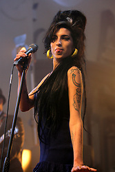 Amy Winehouse performs during an exclusive Vodafone TBA concert at Circomedia in Bristol.