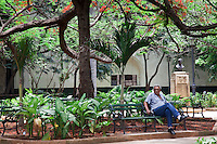 Small shady parks in Old Havana provide a welcome respite from the heat.