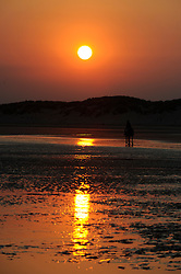 © Licensed to London News Pictures. 25/07/2012 .An evening sunset on Camber Sands Beach tonight (25/07/2012).Camber Sands beach in East Sussex .Photo credit : Grant Falvey/LNP
