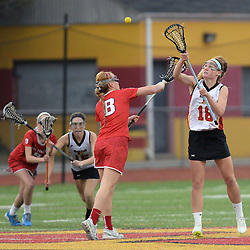 Staff photos by Tom Kelly IV<br /> Haverford's Mairead Janzer (18) faces off against Plymouth Whitemarsh's Kirsten Monte (8).