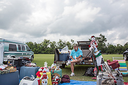 man in South Carolina selling things at a flea market