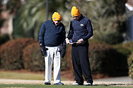 WILMINGTON, NC - MARCH 19: Kent State's Gisli Sveinbergsson (ISL) (right) consults with head coach Herb Page before teeing off on the Ocean Course fourth hole. The first round of the 2017 Seahawk Intercollegiate Men's Golf Tournament was held on March 19, 2017, at the Country Club of Landover Nicklaus Course in Wilmington, NC.