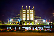 "Light painting projection by marine conservation campaign group Our Fish reading ""Hey EU! Stop the Overfishing"" outside the Brussels Seafood Expo, which opens on April 25.  Despite the reformed Common Fisheries Policy coming into force in January 2014, many EU countries are falling behind in their obligations to enforce the new rules, leading to continuation of unsustainable fishing in Europe's waters. According to a recent EU Scientific, Technical and Economic Committee for Fisheries (STECF) report, six out of ten North Atlantic fisheries are unsustainable, while the Mediterranean is 96% overfished. <br /> <br /> Photo Copyright Our Fish/Dave Walsh. Permission granted for publication regarding 2017 Global Seafood Expo. Credit line must be included. <br /> <br /> <br /> Our Fish works to ensure European member states implement the Common Fisheries Policy and achieve sustainable fish stocks in European waters.<br /> <br /> Our Fish brings together organisations from across Europe to speak with a common voice: overfishing of our waters must be stopped, and solutions put in place that ensure Europe's waters are fished sustainably. Our Fish demands that the Common Fisheries Policy be properly enforced, and Europe's fisheries effectively governed.<br /> <br /> Our Fish calls on all EU Member States to set annual fishing limits at sustainable limits based on scientific advice, and to ensure that their fishing fleets prove that they are fishing sustainably, through monitoring and full documentation of their catch.<br /> http://www.ourfish.eu"