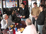 Dayton Gems forwards (standing, from left) Mike Vaskivuo, Corey Couturier, and Jonathan Ornelas stopped by Brixx Ice Company during lunch to visit with fans (and potential fans,) across from Fifth Third Field, Tuesday, January 19, 2010.  Gems forward Sam Bloom was there, too.