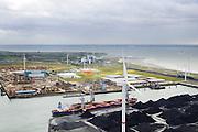 Nederland, Zeeland, Borssele, 23-10-2013; energielandschap, haven bij Borssele. Opslag van steenkool, windmolens aan de dijk van de Westerschelde met o.a. het oranje gebouw van COVRA (Centrale Organisatie Voor Radioactief Afval) , kerncentrale Borssele middenboven.<br /> Port and  industrial area with storage of coal and COVRA, a company that handles the storage of radioactive waste. In the back nuclear plant Borssele (m).<br /> luchtfoto (toeslag op standaard tarieven);<br /> aerial photo (additional fee required);<br /> copyright foto/photo Siebe Swart.