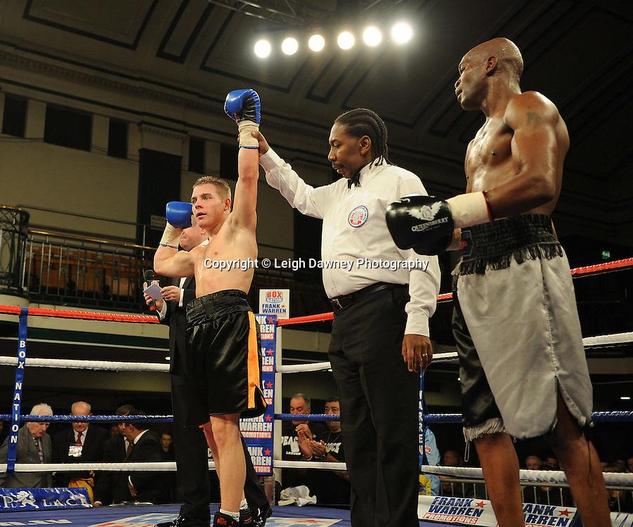 Alfie Smith (black shorts) defeats Jason Nesbitt in a 4x3 min rounds Welterweight contest at York Hall, Bethnal Green, London on 14th December 2011. Frank Warren Promotions. Photo credit: © Leigh Dawney 2011.