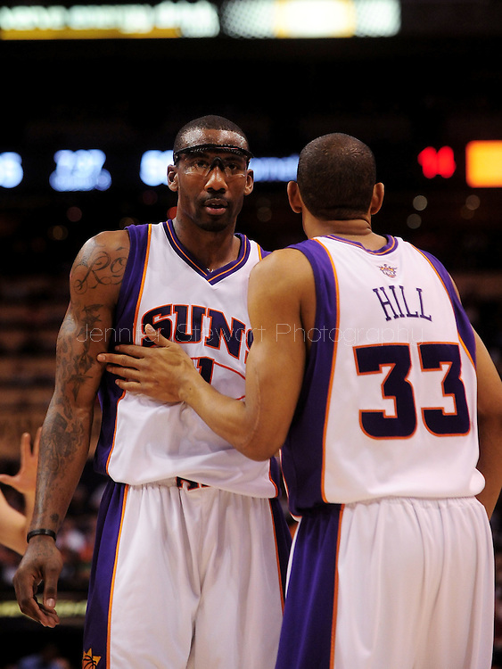 Mar. 14 2010; Phoenix, AZ, USA; Phoenix Suns forward Amare Stoudemire (1) is congratulated by teammate forward Grant Hill (33) at the US Airways Center. The Suns defeat the Hornets 120 to 106. Mandatory Credit: Jennifer Stewart-US PRESSWIRE.
