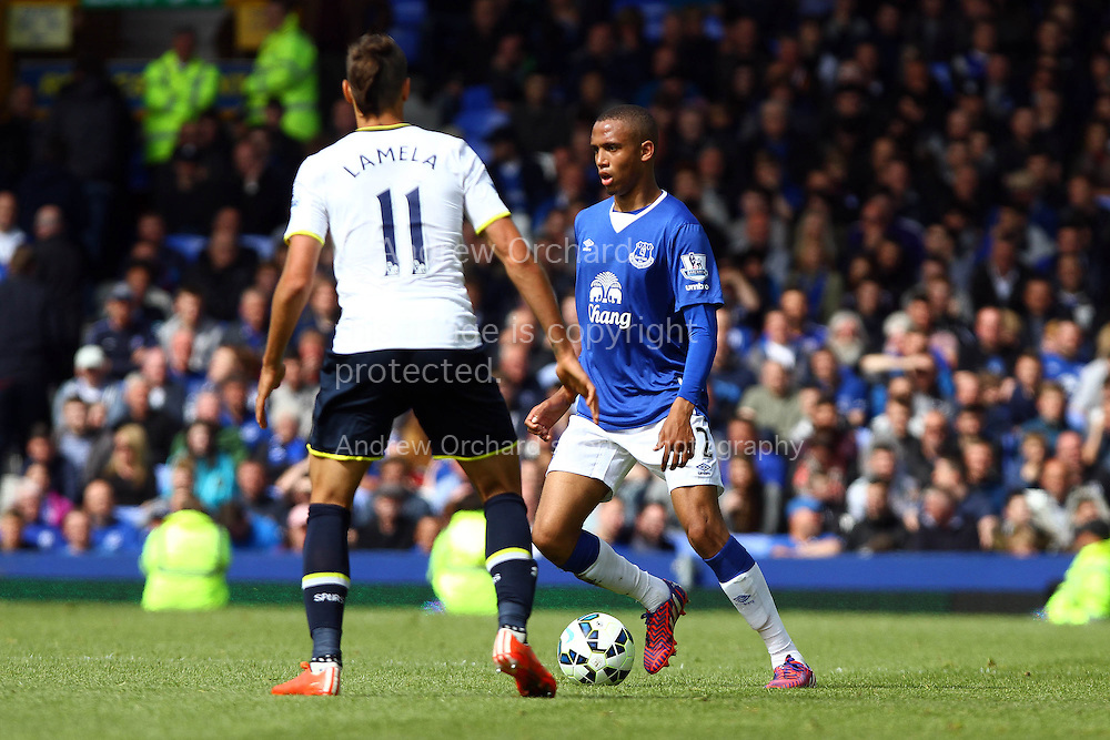 Brendan Galloway of Everton looks to go past Erik Lamela of Tottenham. Barclays Premier League match, Everton v Tottenham Hotspur at Goodison Park in Liverpool on Sunday 24th May 2015.<br /> pic by Chris Stading, Andrew Orchard sports photography.