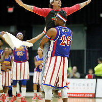 "Thomas Wells | Buy at PHOTOS.DJOURNAL.COM<br /> Jeremy Harbin of Fulton enjoys a little dance with Harlem Globetrotter ""Hi-Lite"" during their show on Tuesday at BancorpSouth Arena."