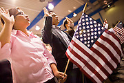 "July 2 - PHOENIX, AZ: New US citizens take the oath of citizenship at South Mountain Community College in Phoenix, Friday. Nearly 200 people were sworn in as US citizens during the ""Fiesta of Independence"" at South Mountain Community College in Phoenix, AZ, Friday. The ceremony is an annual event on th 4th of July weekend and usually the largest naturalization ceremony of the year in the Phoenix area.  Photo by Jack Kurtz"