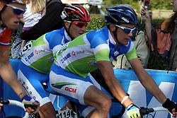 Borut Bozic (Slovenia) and Janez Brajkovic (Slovenia) during the Men's Elite Road Race at the UCI Road World Championships on September 25, 2011 in Copenhagen, Denmark. (Photo by Marjan Kelner / Sportida Photo Agency)