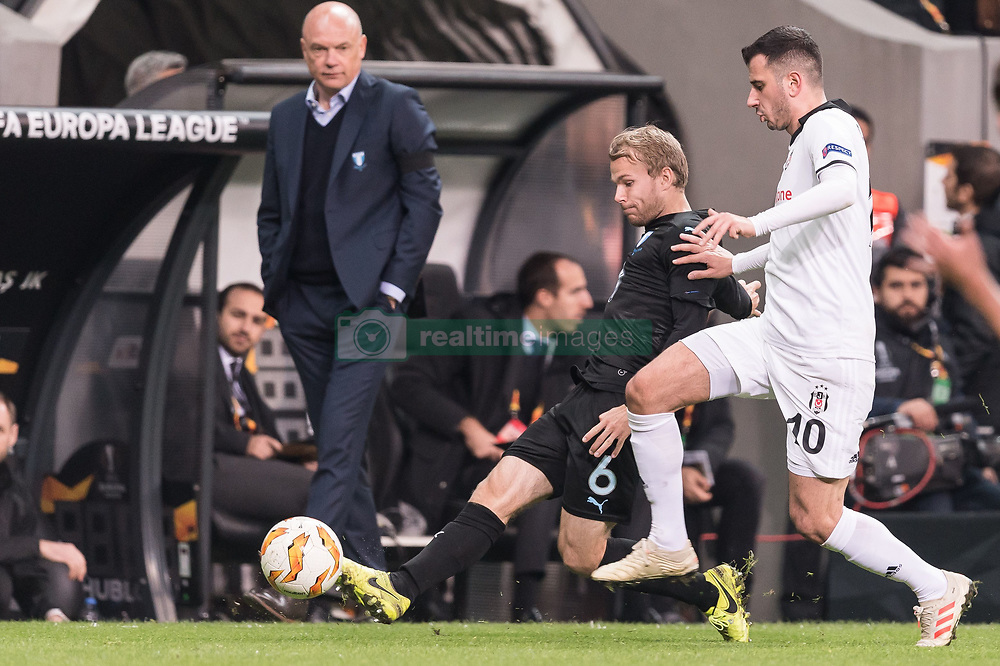 (L-R) coach Uwe Rosler of Malmo FF, Oscar Lewicki of Malmo FF, Oguzhan Ozyakup of Besiktas JK during the UEFA Europa League group I match between between Besiktas AS and Malmo FF at the Besiktas Park on December 13, 2018 in Istanbul, Turkey