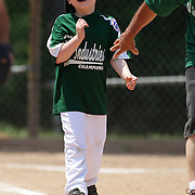 Delight as batter heads towards first base after a hit during the Norwalk Little League baseball 'Champions' team V Greenwich in the Challenger Division  Recognition Day competition. The day acknowledged the many talents of the great players on the Challenger Division teams. The division has weekly games and practices for kids with special needs. Challenger division are held throughout the country.  Broad River Fields, Norwalk, Connecticut. USA. 2nd June 2013. Photo Tim Clayton