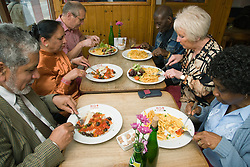 Group of friends out together eating in a restaurant,