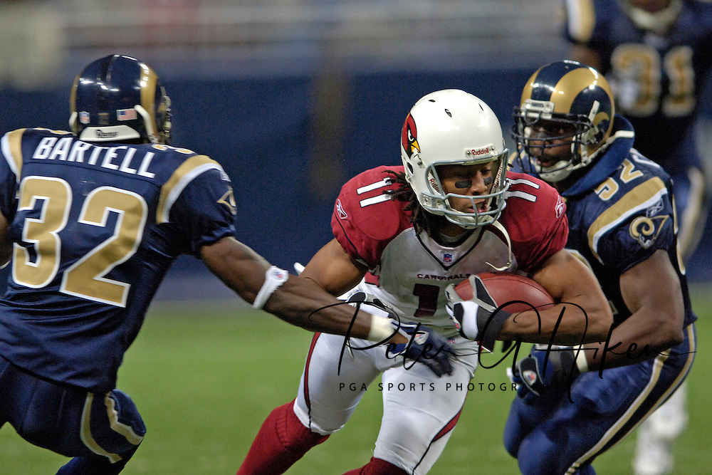 Arizona wide receiver Larry Fitzgerald (11) dives for extra yardage as St. Louis Rams defenders Ron Bartell (32) and Dexter Coakley (52) close in for the tackle at the Edward Jones Dome in St. Louis, Missouri, November 20, 2005.  The Cardinals beat the Rams 38-28.