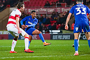AFC Wimbledon forward Kwesi Appiah (9) takes a shot during the The FA Cup match between Doncaster Rovers and AFC Wimbledon at the Keepmoat Stadium, Doncaster, England on 19 November 2019.
