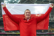 Great Britain, London - 2017 August 11: Wojciech Nowicki (Podlasie Bialystok) of Poland poses with flag and celebrate his bronze medal in men&rsquo;s hammer throw final during IAAF World Championships London 2017 Day 8 at London Stadium on August 11, 2017 in London, Great Britain.<br /> <br /> Mandatory credit:<br /> Photo by &copy; Adam Nurkiewicz<br /> <br /> Adam Nurkiewicz declares that he has no rights to the image of people at the photographs of his authorship.<br /> <br /> Picture also available in RAW (NEF) or TIFF format on special request.<br /> <br /> Any editorial, commercial or promotional use requires written permission from the author of image.