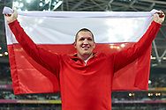 Great Britain, London - 2017 August 11: Wojciech Nowicki (Podlasie Bialystok) of Poland poses with flag and celebrate his bronze medal in men's hammer throw final during IAAF World Championships London 2017 Day 8 at London Stadium on August 11, 2017 in London, Great Britain.<br /> <br /> Mandatory credit:<br /> Photo by © Adam Nurkiewicz<br /> <br /> Adam Nurkiewicz declares that he has no rights to the image of people at the photographs of his authorship.<br /> <br /> Picture also available in RAW (NEF) or TIFF format on special request.<br /> <br /> Any editorial, commercial or promotional use requires written permission from the author of image.