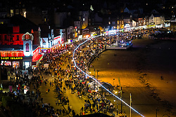 Crowds flood onto the the road after the Scarborough Goldwing Light Parade 2015 from the terrace of the Grand Hotel<br />