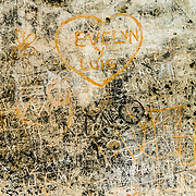 Graffiti on the walls of what was once the kitchen of the monastery and church of Santa Clara (Saint Clair) in Antigua, Guatemala. The original foundation dates back to 1700 and the church was consecrated in 1715. It was run by nuns from the Second Franciscan Order of Poor Sisters of Saint Clair. In 1717 the earthquake of San Miguel caused extensive damages to the building. The church is now in ruins and is no longer a functional church.