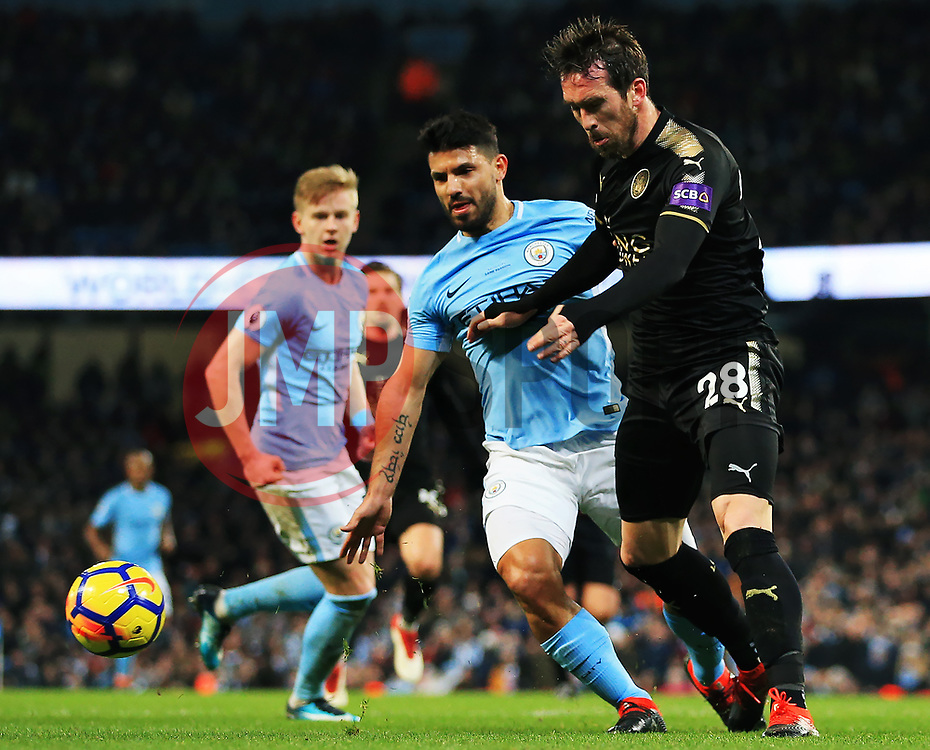 Christian Fuchs of Leicester City clears under pressure from Sergio Aguero of Manchester City - Mandatory by-line: Matt McNulty/JMP - 10/02/2018 - FOOTBALL - Etihad Stadium - Manchester, England - Manchester City v Leicester City - Premier League