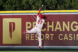 May 18, 2018 - Anaheim, California, U.S. - Mike Trout (27) of the Angels goes up high over the fence to make a catch but looses the grip on the ball as he goes face first into the wall, the ball comes loose and falls over the fence for a home run by Wilson Ramos of the Rays during the major league baseball game between the Tampa Bay Rays and the Los Angeles Angels at Angel Stadium. (Credit Image: © Cliff Welch/Icon SMI via ZUMA Press)