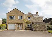 Two Storey faux Cotswold house with PVC double glazed windows and garage in Painswick. Gloucestershire, England