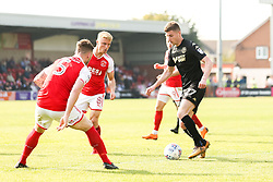 Ryan Colclough of Wigan Athletic takes on Ashley Eastham of Fleetwood Town and Kyle Dempsey of Fleetwood Town - Mandatory by-line: Robbie Stephenson/JMP - 21/04/2018 - FOOTBALL - Highbury Stadium - Fleetwood, England - Fleetwood Town v Wigan Athletic - Sky Bet League One
