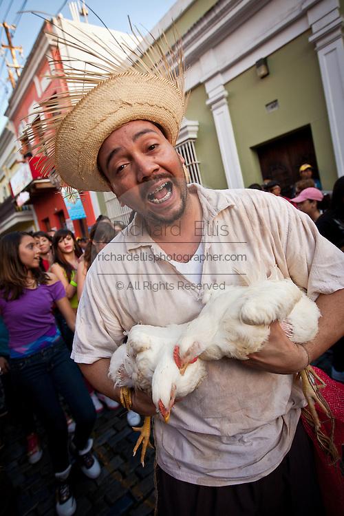 A reveler dressed in traditional Puerto Rican costume at the Festival of San Sebastian in San Juan, Puerto Rico.