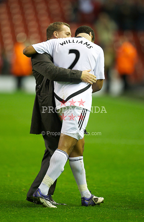 LIVERPOOL, ENGLAND - Saturday, November 5, 2011: Swansea City's manager Brendon Rodgers kisses his defender Ashley Williams after his side's goal-less draw against Liverpool during the Premiership match at Anfield. (Pic by David Rawcliffe/Propaganda)