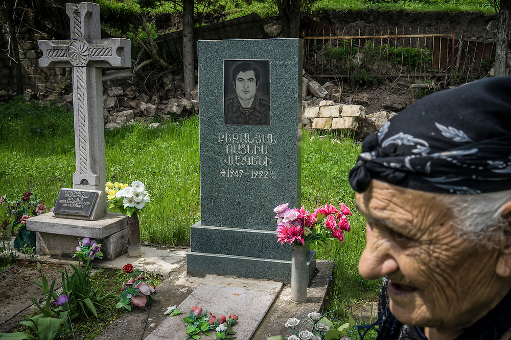 HAKOB KAMARI, NAGORNO-KARABAKH - APRIL 20: Zabela Bejanyan, 88, at the grave of her son Raynis Bejanyan, who was killed in the war between Armenia and Azerbaijan over Nagorno-Karabakh, on April 20, 2015 in Hagob Kamari, Nagorno-Karabakh. Since signing a ceasefire in a war with Azerbaijan in 1994, Nagorno-Karabakh, officially part of Azerbaijan, has functioned as a self-declared independent republic and de facto part of Armenia, with hostilities along the line of contact between Nagorno-Karabakh and Azerbaijan occasionally flaring up and causing casualties. (Photo by Brendan Hoffman/Getty Images) *** Local Caption *** Zabela Bejanyan