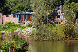 Bren Cottage, home of artist Jita Lukka, 57, is built without planning consent, from recycled materials on land overlooking the Vale of Health Pond in leafy Hampsead in West London, has to be pulled down after an appeal to Camden Council failed. London, September 20 2019.