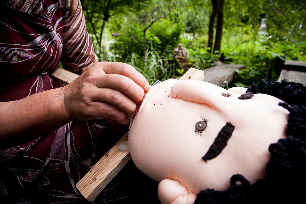 MIYOSHI, JAPAN - JULY 11 :  Tsukimi Ayano making dolls in front of her house in Nagoro village, Miyoshi, Japan on July 11, 2015. Nagoro is a slowly shrinking village located in the valleys of Shikoku, Japan. According to Japan's Statistic Bureau, the percentage of people over 65 years old in Japan is 26.8% while that of the the world is 8.2%. The National Institute of Population and Social Security Research in Tokyo, Japan's population, now around 128 million, is expected to dip below 100 million in 2046.<br /> <br /> Photo: Richard Atrero de Guzman