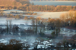 © Licensed to London News Pictures. 16/02/2014. Winchester, Hampshire, UK. Valley mist in the Itchen valley near Winchester, Hampshire at sunrise. The sunshine offers respite to the seemingly never ending stormy period experienced in the UK. Photo credit : Rob Arnold/LNP