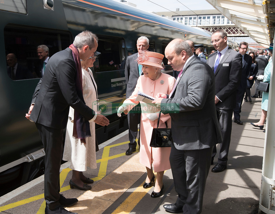 Queen Elizabeth II meeting Isambard Thomas, Great Great Great Grandson of Isambard Kingdom Brunel, before getting on a train at Slough station to travel to Paddington Station to mark the 175th anniversary of the first train journey by a British monarch.